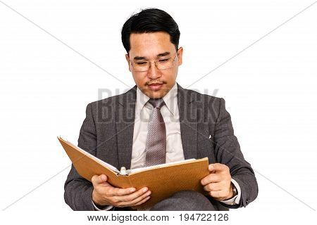 Businessman with hardback book on a white background.