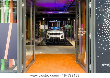 STUTTGART GERMANY - MARCH 18 2016: Land Rover showroom and a car Range Rover Evoque. Historical Street Calwer Strasse in the city center. Stuttgart is the capital and largest city of the state of Baden-Wuerttemberg.