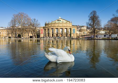 STUTTGART GERMANY - MARCH 18 2016: The Staatstheater Stuttgart (Stuttgart State Theatre) and Eckensee pond and white swan in the foreground.