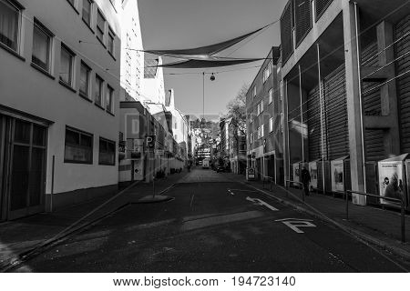 STUTTGART GERMANY - MARCH 18 2016: The streets of the city. Black and white. Stuttgart is the capital and largest city of the state of Baden-Wuerttemberg.
