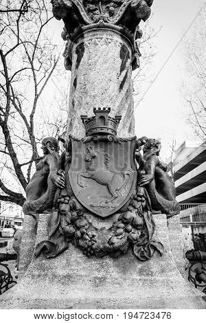 STUTTGART GERMANY - MARCH 18 2016: The coat of arms of the state of Baden-Wuerttemberg on water source