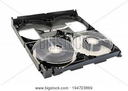 Opened video cassette tape on white background.