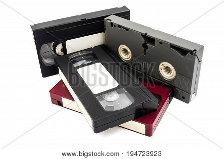 Video cassette tapes on a white background.