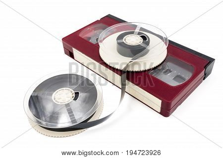 Video cassette tape and reel on white background.