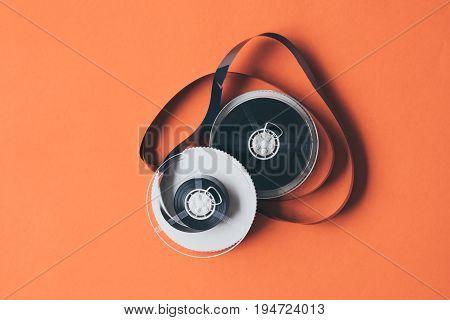 Film for video cassette tape on orange background.