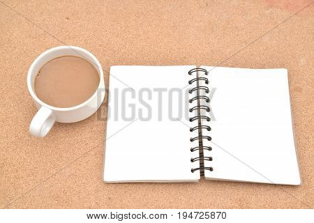 Blank Spiral Note Pad Cup of Coffee on Wood Background.