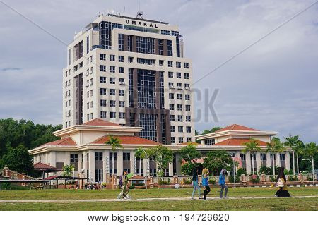 Labuan,Malaysia-May 17,2017:View of UMS Labuan International Campus with university student walking to the class in Labuan,Malaysia.The university has started its operation with the intake of the first students in May 1999