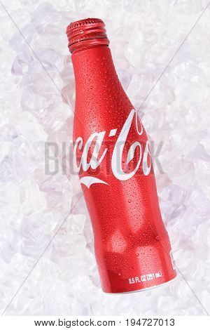 IRVINE CALIFORNIA - JULY 10 2017: Coca-Cola Aluminum Bottle on ice. Coke first introduced the aluminum bottle in 2015 claiming it is their hardest package to produce.