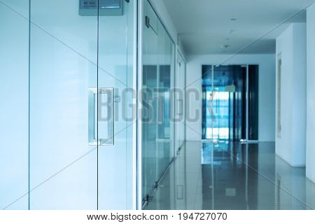 Modern office interior, Blue toned, selective focus on doorknob