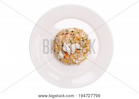 Tasty Thai cuisine crab meat fried rice beautiful serving in white plate isolated on white background.