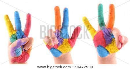 Little boy's colorful hands all making a three - High resolution studio image.