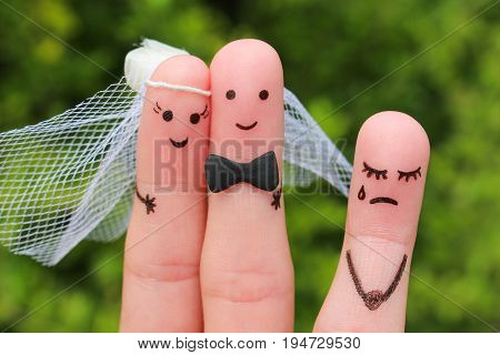 Finger art of Happy couple to get married. Other woman upset.