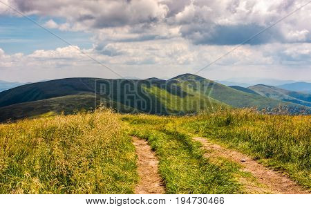 beautiful summer landscape in mountains. fine weather with blue sky and some clouds. gorgeous travel background with footpath through the mountain ridge