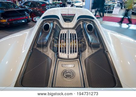 STUTTGART GERMANY - MARCH 17 2016: The engine compartment of a mid-engined plug-in hybrid sports car Porsche 918 Spyder 2015. Close-up. Europe's greatest classic car exhibition