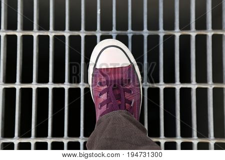 Background youth foot wear step metal bars