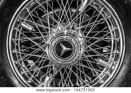 STUTTGART GERMANY - MARCH 17 2016: Wheel and brake system of full-size luxury car Mercedes-Benz 770K Cabriolet D (W07) 1931. Black and white. Europe's greatest classic car exhibition