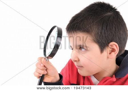 Little child looking through a magnifying glass isolated on white background