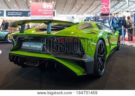 STUTTGART GERMANY - MARCH 17 2016: Mid-engined sports car Lamborghini Aventador LP 750-4 SuperVeloce 2016. Rear view. Europe's greatest classic car exhibition