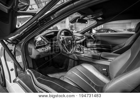 STUTTGART GERMANY - MARCH 17 2016: Cabin of a plug-in hybrid sports car BMW i8. Black and white. Europe's greatest classic car exhibition