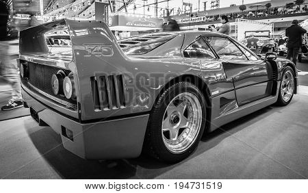 STUTTGART GERMANY - MARCH 17 2016: Sports car Ferrari F40 1989. Rear view. Black and white. Europe's greatest classic car exhibition