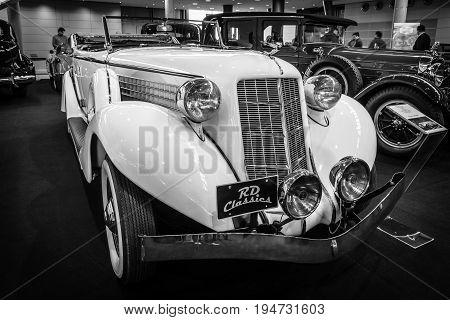 STUTTGART GERMANY - MARCH 17 2016: Vintage car Auburn 852 Phaeton Sedan 1936. Black and white. Europe's greatest classic car exhibition