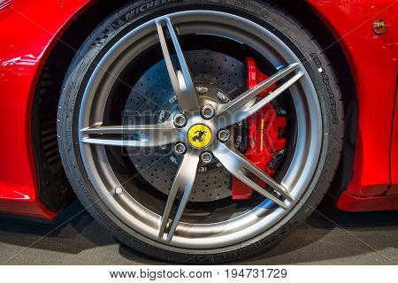 STUTTGART GERMANY - MARCH 17 2016: The brake system of sports car Ferrari 458 Italia 2014. Europe's greatest classic car exhibition