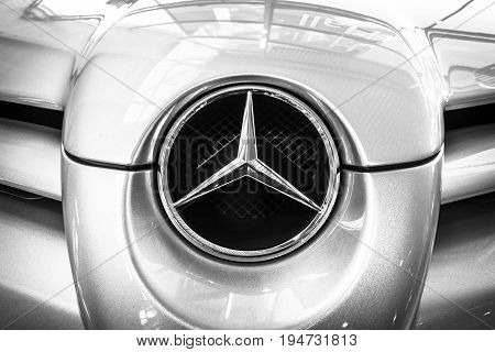 STUTTGART GERMANY - MARCH 17 2016: Fragment of a grand tourer car Mercedes-Benz SLR McLaren 2006. Black and white. Europe's greatest classic car exhibition