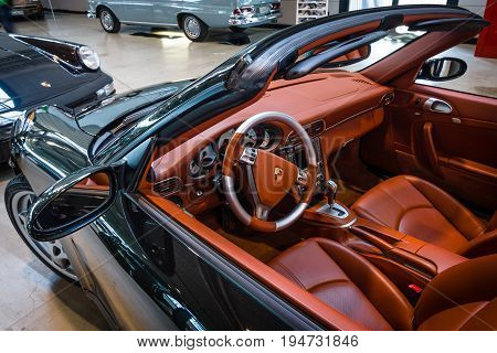 STUTTGART GERMANY - MARCH 17 2016: Cabin of a sports car Porsche 911 Carrera 4S Cabriolet. Europe's greatest classic car exhibition