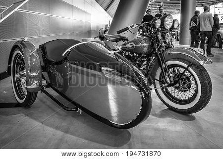 STUTTGART GERMANY - MARCH 17 2016: Motorcycle Harley-Davidson WLA 45 Gespann 1944 with sidecar Simard Rocketman 1934. Black and white. Europe's greatest classic car exhibition