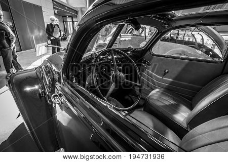 STUTTGART GERMANY - MARCH 17 2016: Cabin of large family car Peugeot 402 Legere E 1939. Black and white. Europe's greatest classic car exhibition