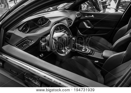 STUTTGART GERMANY - MARCH 17 2016: Cabin of compact car Peugeot 308 GTi 2015. Black and white. Europe's greatest classic car exhibition