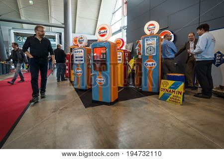 STUTTGART GERMANY - MARCH 17 2016: Sales and distribution of refrigerators and showcases in the form of gas stations. Europe's greatest classic car exhibition