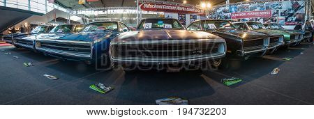 STUTTGART GERMANY - MARCH 17 2016: Various Dodge Charger (Muscle car) modesl 500 and R/T are standing in a row. Panoramic view. Europe's greatest classic car exhibition