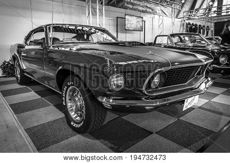 STUTTGART GERMANY - MARCH 17 2016: Pony car Ford Mustang Mach 1 Sportsroof 1969. Black and white. Europe's greatest classic car exhibition