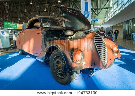 STUTTGART GERMANY - MARCH 17 2016: Large family car Peugeot 402 Eclipse 1938. Europe's greatest classic car exhibition