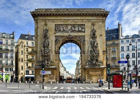 Paris France - May 16 2017: The Porte Saint-Denis built in 1672 designed by architect Francois Blondel at the order of Louis XIV in Paris France.