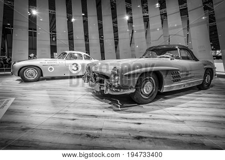 STUTTGART GERMANY - MARCH 17 2016: Racing car Mercedes-Benz 300 SL (W194) and the sports car Mercedes-Benz 300 SL Roadster (W198). Black and white. Europe's greatest classic car exhibition