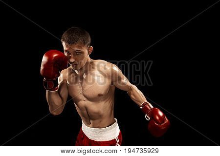 Male Athlete boxer boxing with dramatic edgy lighting in a dark studio