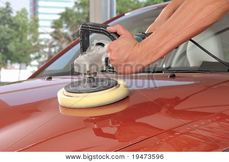 Car care with power buffer machine at service station - a series of CAR CARE images. poster