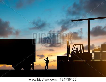 Silhouette security staff stood waving truck with the Forklift. Truck bringing up the goods in warehouses over blurred natural background sunset pastel.Business Logistics and Transportation concept.