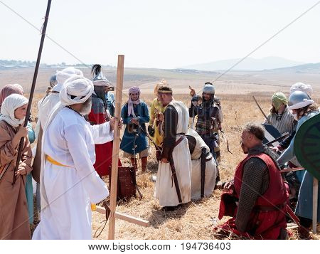 Tiberias Israel July 01 2017 : Participant in the reconstruction of Horns of Hattin battle in 1187 acting as Saladin talking to the prisoners after the battle near Tiberias Israel
