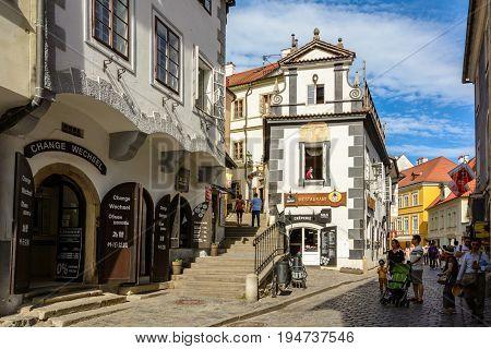Cesky Krumlov - June 9, 2017: Tourists on a pedestrian street in the Czech Krumlov, Czech Republic