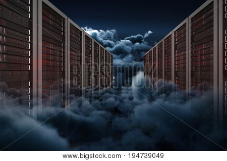 Server towers against scenic view of overcast at night