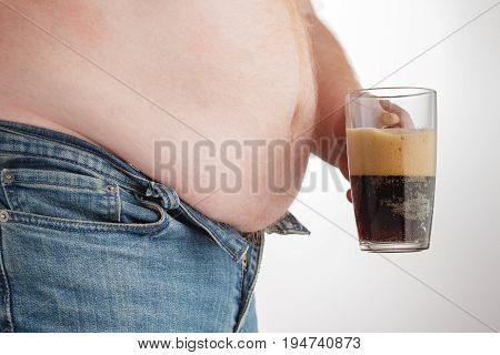 Man With Big Belly Holding A Glass Of Fizzy Soda