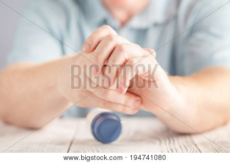 An Applying Moisturizer Cream On Hands, Dry Skin On White Background. Dermatology, Cold Weather Skin