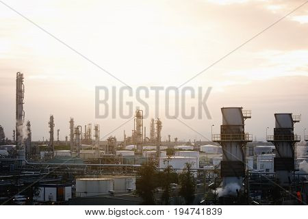 Petrochemical plant view on sky sunset background