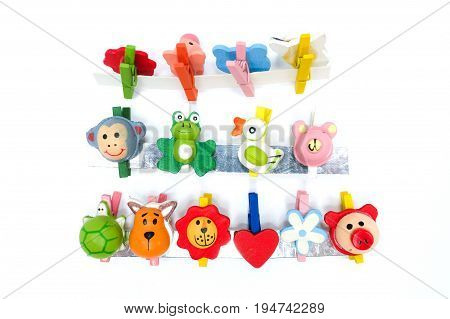Animal And Flower Clothespins, Isolated On A White Background