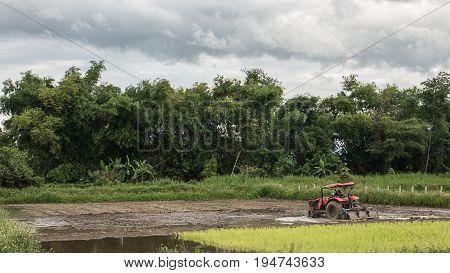 working farner tiller in Southeast Asia landscape