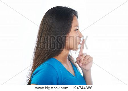 Young girl making shh gesture isolated on white background