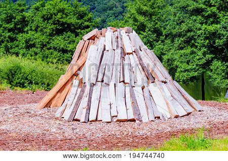 Conical stacked Woodlogs for the manufacture of charcoal.